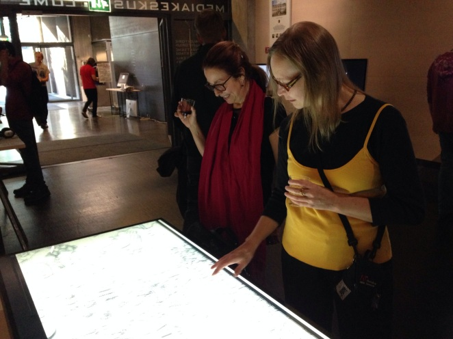 Two woman interacting with the map of Mexico